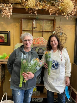 Kiwanis members Diane Seddon and Shirley Iverson at the Tulip Sale fundraiser at Montagues Flower Shop