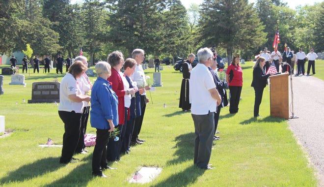"""Margee Keller reads """"In Flanders Fields"""" on Memorial Day in Oakdale Cemetery."""