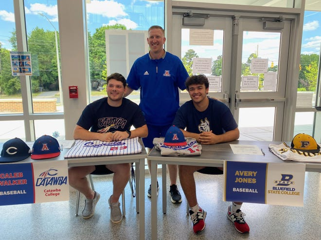 Asheboro baseball players Caleb Walker (left) and Avery Jones (right) have signed letters of intent to play college baseball. Walker signed with Catawba and Jones inked his letter with Bluefield State. Both played big roles in the Blue Comets' come-from-behind 10-9 win over Southwestern Randolph on Monday. [Contributed photo]