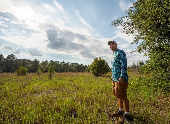 Loren Howell shows what he says is protected wetlands at the edge of his property in unincorporated Lake County south of Leesburg on Thursday, May 27, 2021. [PAUL RYAN / CORRESPONDENT]