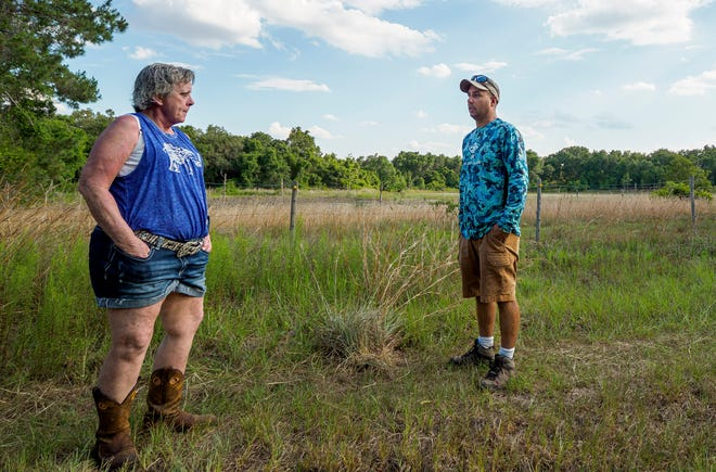 Karen Thomas, left, and Loren Howell discuss the proposed development at his property in unincorporated Lake County south of Leesburg on Thursday, May 27, 2021. [PAUL RYAN / CORRESPONDENT]