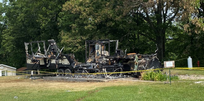 Crime scene tape surrounds the burnt remains of a camper where 39-year-old David O. Reagan died during a standoff with law enforcement agencies late Saturday night. The standoff followed an alleged domestic dispute involving Reagan and an unidentified woman at Salt Fork State Park and a subsequent pursuit from the park to the residential area on East Pike Road outside Old Washington.