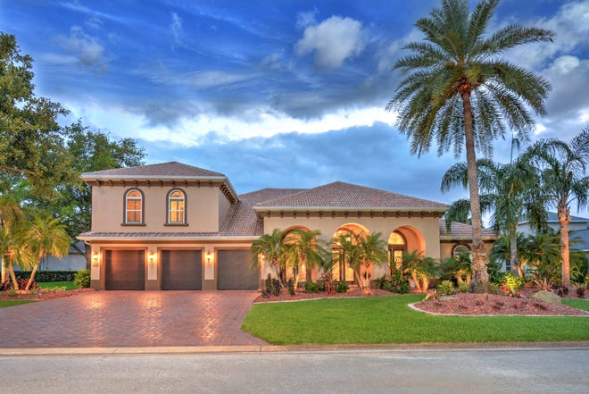 This stunning Ormond Beach pool estate, built by the Johnson Group, is adorned with beautiful finishes and features.