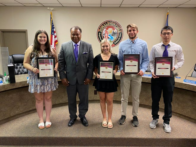 Donaldsonville Mayor Leroy Sullivan honored the valedictorians and salutatorian of the Ascension Catholic Class of 2021. They are, from left: Salutatorian Emma Ball, Valedictorian Miranda Landry, Valedictorian Matthew LaFleur, and Valedictorian Qin Jiang. Additionally, the teachers of the year were recognized. They are: Tammy Matirne, Connie Louis, and Briggette Dunn.