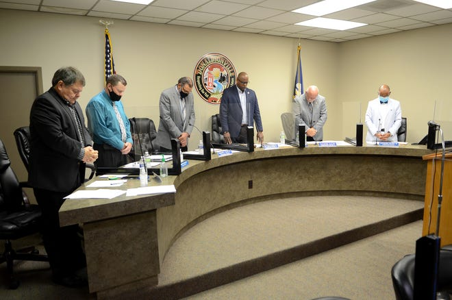 The Donaldsonville City Council stands for the invocation during the May 25 meeting.