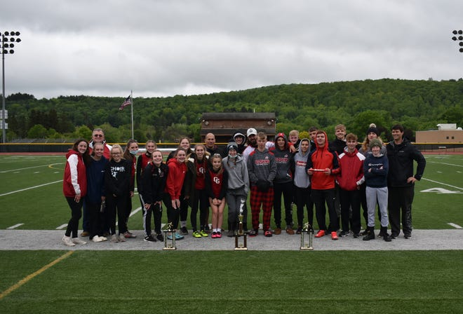 The Canisteo-Greenwood Boys' and Girls' Varsity Track and Field teams gather with their trophies after both finished first in the team standings at the Wellsville Elks Spring Day on Saturday and were named Overall Champions of the Invitational.