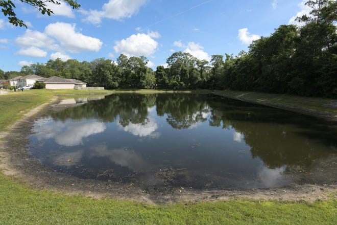 The retention pond alongside Chester Creek Road where a 3-year-old child with autism drowned Monday, police said.