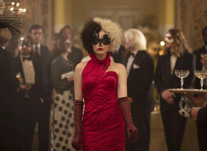 """Emma Stone stars in """"Cruella,"""" a crime comedy aboutthe evil exploits of Cruella de Vil, the villain from the Disney film """"101 Dalmatians."""""""