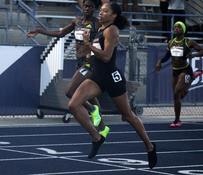 Allyson Felix of the United States (center) leans across the line to win the women's 400-meter run at the American Track League's Duval County Challenge at the University of North Florida's Hodges Stadium on May 31, 2021. [Clayton Freeman/Florida Times-Union]