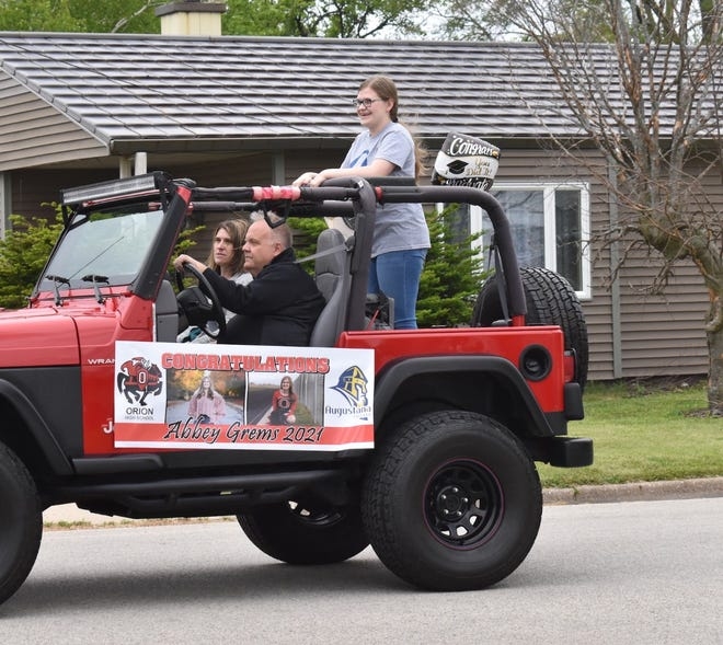 Abbey Grems rides in the Orion senior parade on Sunday, May 16. Last year COVID-19 protocols prevented Orion High School from having in-person graduation in May, so the school organized a senior parade during the hour graduation would have been held. The parade was so popular that it was brought back this year.