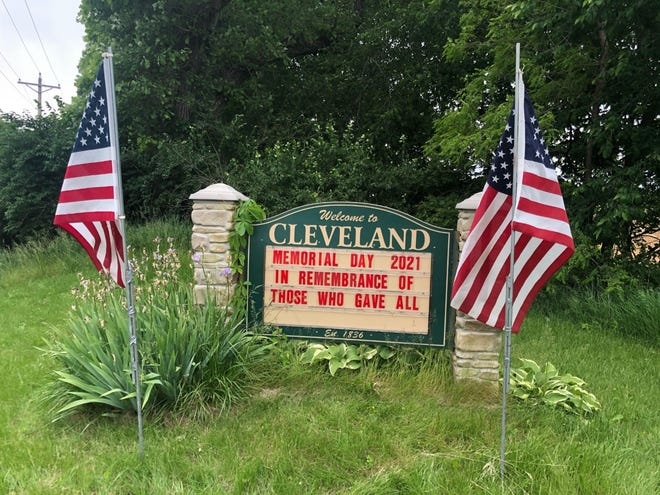 The Village of Cleveland honored Memorial Day  with this display posted by Trustee Sherri Stout, and residents Mike and Alex Erickson.