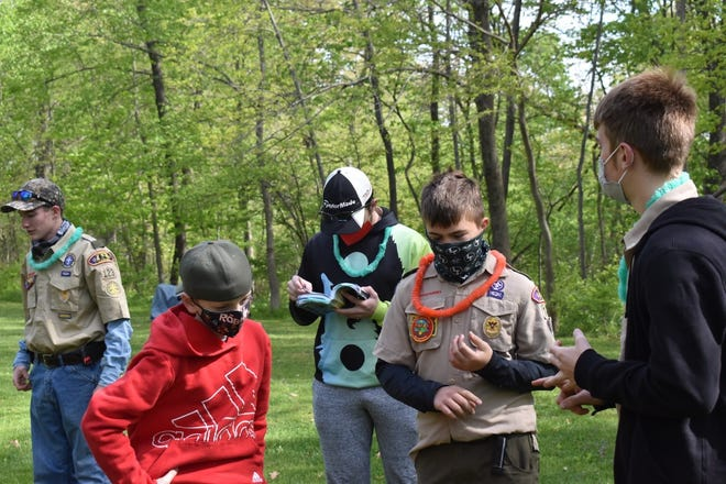 Reviewing outdoor ethics while waiting for a contest judge are, in front from left, Orion Boy Scouts Garrett Nichols, Micah Knox and Eric Thorndyke, and in back, Nick Shillington and Ian Niemeier. They were at Tropical Klondike Derby on Saturday, May 8, at Loud Thunder Boy Scout Reservation near Illinois City