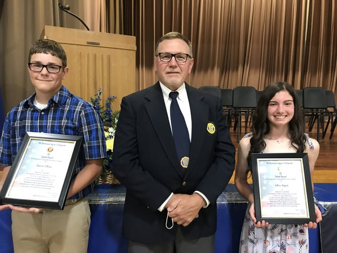 Pictured are Cliff Wright, middle from the Galva American Legion presenting the citizenship awards Wednesday night at the Galva eighth grade promotion to Cameron O'Brien, left and Lillian Wigant, right.