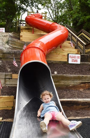 Caroline Philipps, of Somerset, takes a turn on the new Big Red Slide.