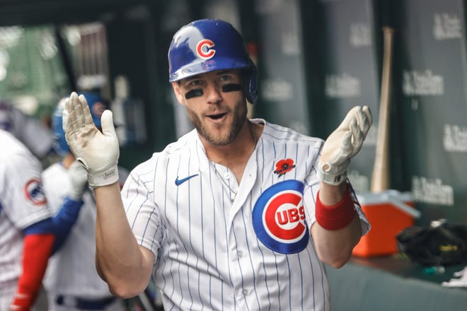 May 31, 2021; Chicago, Illinois, USA; Chicago Cubs third baseman Patrick Wisdom (16) celebrates after hitting a solo home run against the San Diego Padres during the fourth inning at Wrigley Field.