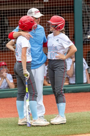 Borden County head coach Rusty Rainbolt speaks with Haddie Flanigan and BK Behrens as they compete against D'Hanis during a Class 1A state semifinal in Austin on June 1.