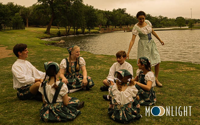"""Maria (portrayed by Lauren Robinson), spends time playing games and having fun with the von Trapp children in this scene from Moonlight Musicals upcoming production of """"The Sound of Music,"""" to open the 2021 season."""
