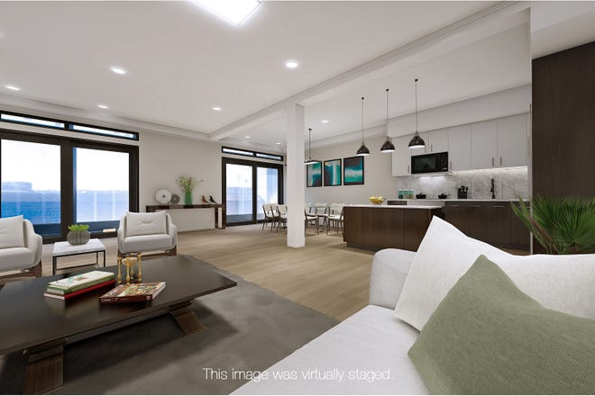 Penthouse residents at The Thorndike will have plenty of gorgeous living room and kitchen space.