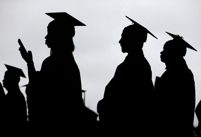 Students line up before the start of the Bergen Community College commencement at MetLife Stadium in East Rutherford, New Jersey, on May 17, 2018. [AP File Photo/Seth Wenig]