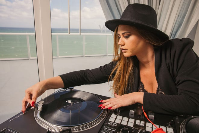 """At The W in Fort Lauderdale, choose from five musical experiences — a keyboardist, a DJ, saxophonist, acoustic guitar duo or a violinist — for """"Suite Sounds"""" in your room."""
