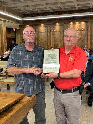 Fire Chief John Marque presents a proclamation to Billy Simmers during the May 25 Iberville Parish Council Meeting.