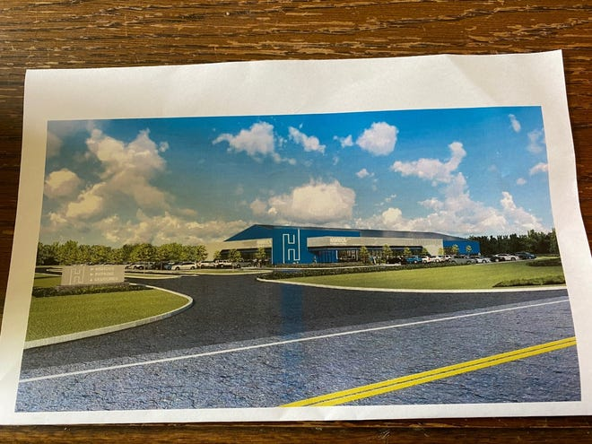 Hamrick Packaging Systems plans to relocate to the Maplecrest development in Brimfield. This is an artist rendering of the building that will be constructed.