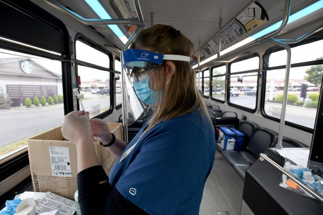 The Stark County Health Dept and SARTA have previously teamed up to offer the COVID-19 vaccine at mobile clinics at McDonald's across the county in early June. Here Allie DeVore with Stark County Health Department prepares a shot inside a SARTA bus during the June 1 clinic in the Hartville McDonalds parking lot.