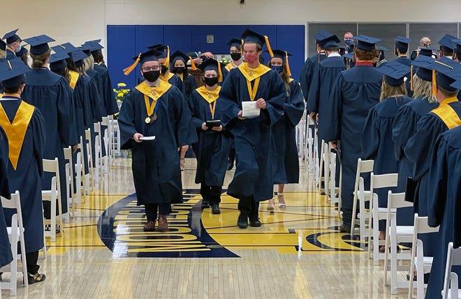 Mooresville High School class of 2021 valedictorian Jacob Eyster, left, and salutatorian Aidan Raymond, lead graduates out of Saturday's ceremony.