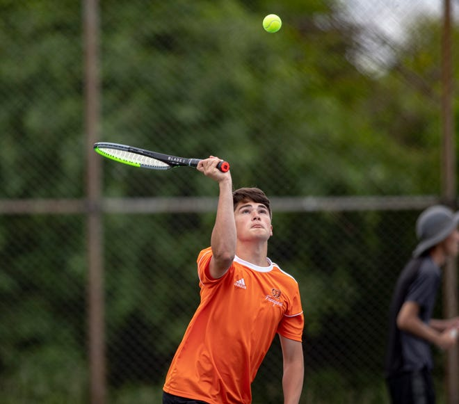 Freeport sophomore Asher Kubly, shown hitting a shot while playing doubles last week at the NIC-10 boys tennis tournament, won his opening Class 1A sectional match at singles Friday before falling in the quarterfinals.