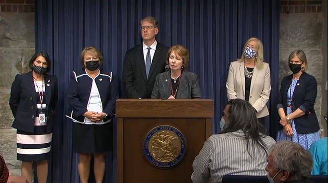 A bipartisan group of lawmakers introduce an ethics package Monday, May 31, 2021, at the Illinois State Capitol. It passed the House Monday night, then the Senate after 1 a.m. Tuesday morning.