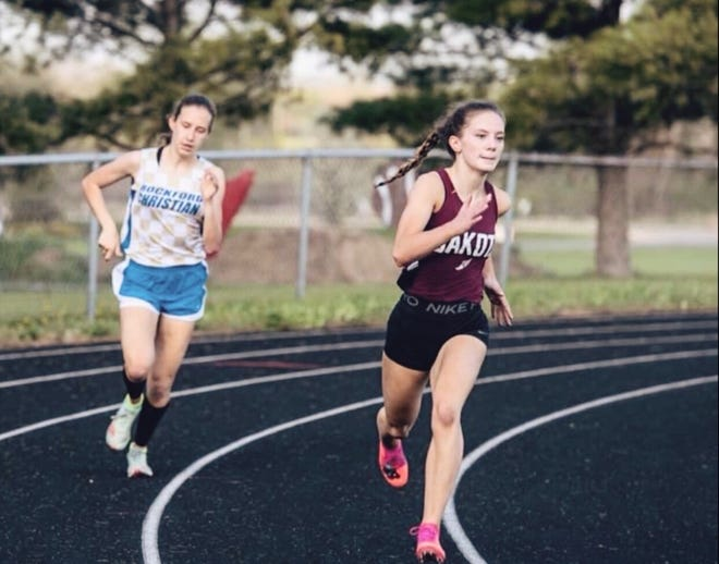 Dakota senior Cali Minkie sprints around the corner during a 400-meter race earlier this season. Minkie is seeded No. 1 for the upcoming sectional in the 400, as well as in the 200, long jump and triple jump.