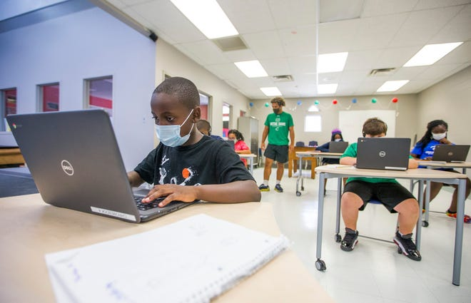 Kennedy Primary Center fourth grader Jonathan Giden, 9, left, uses a computer inside the Boys & Girls Club of St. Joseph County on Wednesday, Aug. 5, 2020, in South Bend.