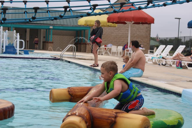 Several swimmers didn't let cloudy skies keep them away from the 'teaser' opening of Splashville over the Memorial Day Weekend holiday.  Splashville will officialy open for the season on Monday, June 7.