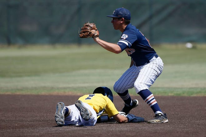 Stephenville's Case Dunavant slides safely into base as El Paso Riverside's Isaac Echiveste attempts to get the out at second during the Class 4A baseball regional semifinals Saturday at Christensen Stadium in Midland. The Jackets went on to win, 6-0.