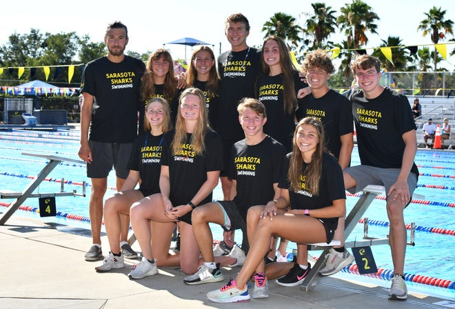 The Sarasota Sharks swim team is sending 11 swimmers to United States Olympic swim trials. Front row, left to right: Eliza Brown, Natalie Mannion, Connor Hunt and Gracie Weyant. Back row, left to right: Nico Hernandez-Tome, Michaela Mattes, Addison Sauickie, Alexander Gusev, Emma Weyant, Amadeusz Knop and Liam Custer.