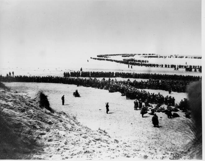 Allied troops wait on the beach of Dunkirk for the rescue ships to take them to England, on June 4, 1940. More than 300,000 soldiers from Belgium, France and England were cut off from retreat on land by the German invasion and had to be evacuated in a heroic emergency sealift code-named Operation Dynamo.