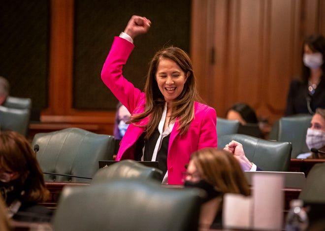 State Rep. Jennifer Gong-Gershowitz, D-Glenview, celebrates the passage of House Bill 367, a bill that requires public schools teach Asian American history, on the floor of the Illinois House of Representatives on the last day of session at the state Capitol on Monday. [Justin L. Fowler/The State Journal-Register]