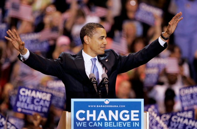 In this June 3, 2008 photo, then-Democratic presidential candidate, Sen. Barack Obama, D-Ill., waves to supporters before speaking at a primary night rally in St. Paul, Minnesota. Obama claimed the Democratic nomination in the speech.