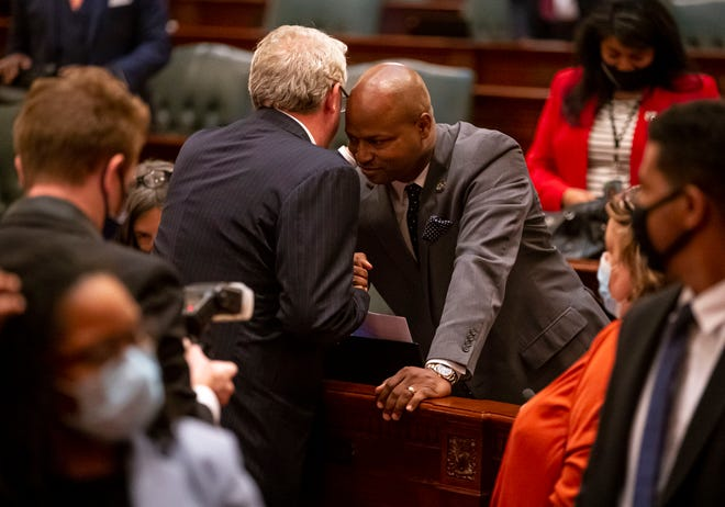 """Illinois House Republican Leader Jim Durkin, R-Western Springs, speaks with Illinois Speaker of the House Emanuel """"Chris"""" Welch, D-Hillside, after the close of session on the floor of the Illinois House of Representatives at the Capitol on June 1. [Justin L. Fowler/The State Journal-Register]"""