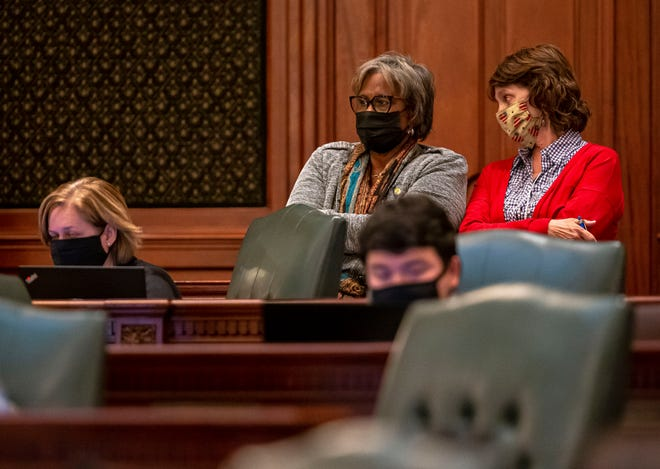 Illinois State Sen. Doris Turner, D-Springfield, left, speaks with Illinois State Rep. Sue Scherer, D-Decatur, on the floor of the Illinois House of Representatives on the last day of session at the Illinois State Capitol in Springfield, Ill., Monday, May 31, 2021. [Justin L. Fowler/The State Journal-Register]