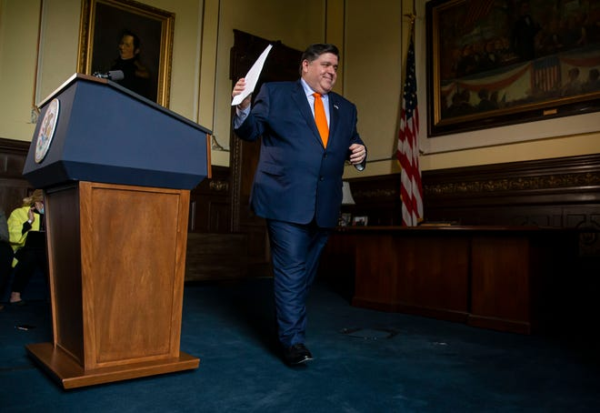 Gov. JB Pritzker leaves the podium after answering questions from the media after he praised the budget passed by the lawmakers during a press conference June 1 in his office at the state Capitol.