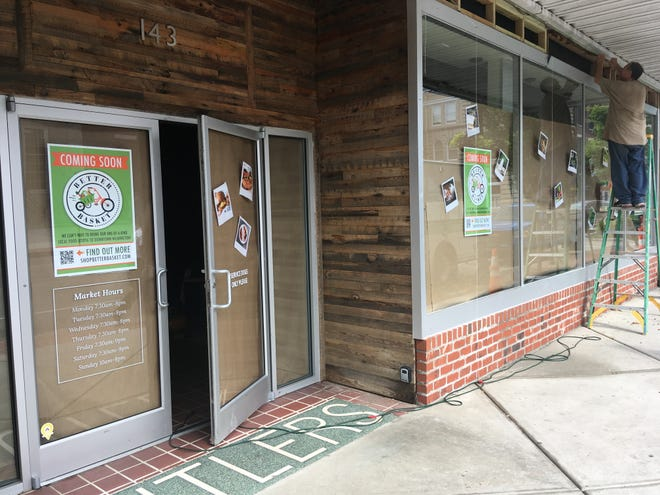 Workers are putting the final touches on Better Basket, a grocery store that should open soon in downtown Wilmington.