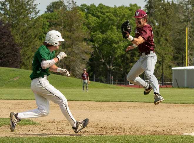 Northbridge first baseman Ryan Boyce leaps to catch a high throw from across the field and comes down to tag out Grafton base runner Brady Keeler during Tuesday's game in Northbridge.