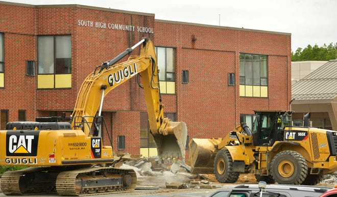 The demolition of South High Community School begins as the parking lot is torn apart Tuesday morning.