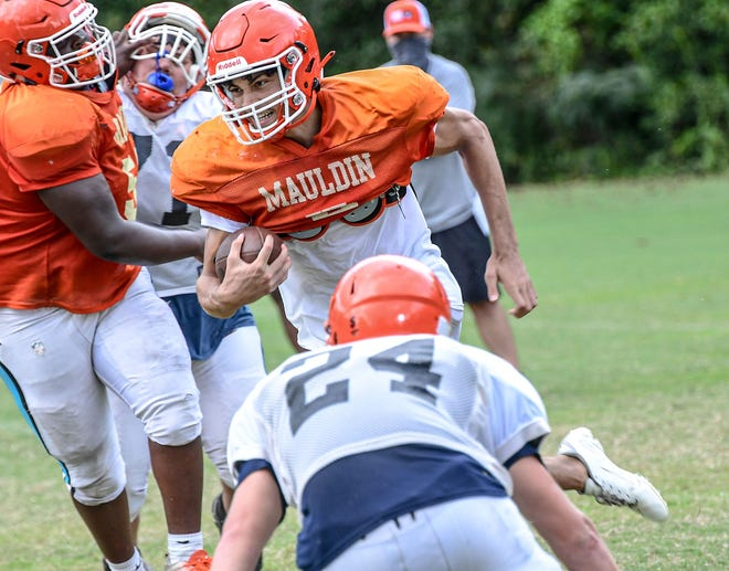 Five-star 2022 cornerback Jeadyn Lukus, pictured here running the ball as a quarterback during a Mauldin (S.C.) High School football practice last September, is taking an official visit to UNC football this weekend.