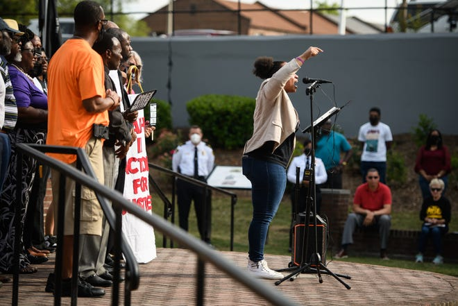 Kathy Greggs, president of the Fayetteville Police Accountability Community Task Force, speaks at a Justice for Andrew Brown rally at Cross Creek Linear Park on June 1, 2021.