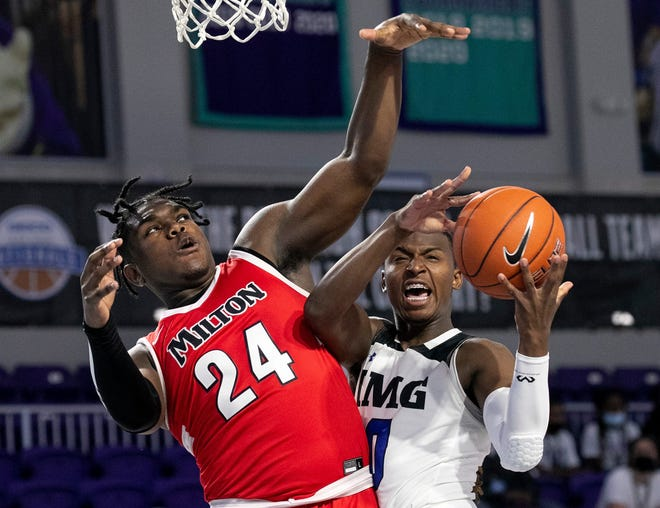 IMG Academy point guard Jaden Bradley (0) takes a shot against Milton High School forward Lebbeus Overton (24) during the Geico High School Nationals Tournament on Thursday, April 1, 2021, at Suncoast Credit Union Arena in Fort Myers, Florida.