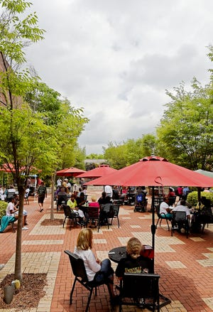 A crowd gathers for Musical Monday at the Water Wall in downtown Gadsden, for jazz music played by DJ Buster Porch and lunch. The event returns on June 14.