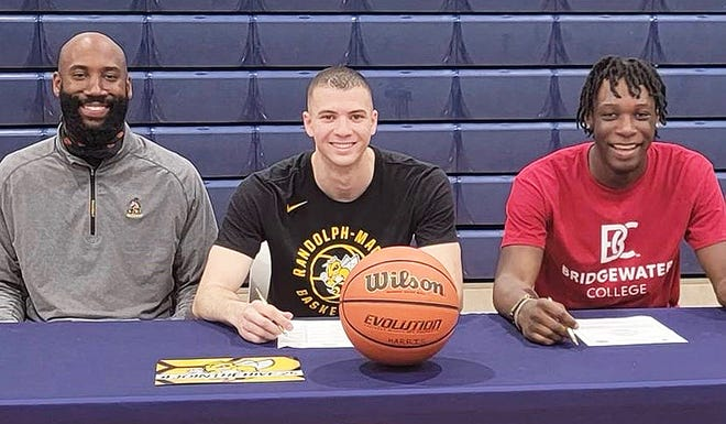 St. Maria Goretti seniors Vincent Payne (center, Randolph-Macon) and Chris Abissi (right, Bridgewater College) will continue their basketball careers in college.