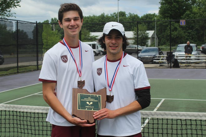 Columbus Academy's Arie Tuckerman and Jack Madison display the third-place plaque from the Division II state team tournament May 30 at Reynoldsburg. Tuckerman and Madison finished second at state in doubles the previous day at Lindner Family Tennis Center in Mason.